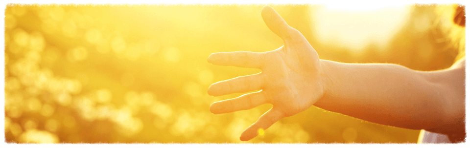 Hand Reaching in Sunlight Banner Image